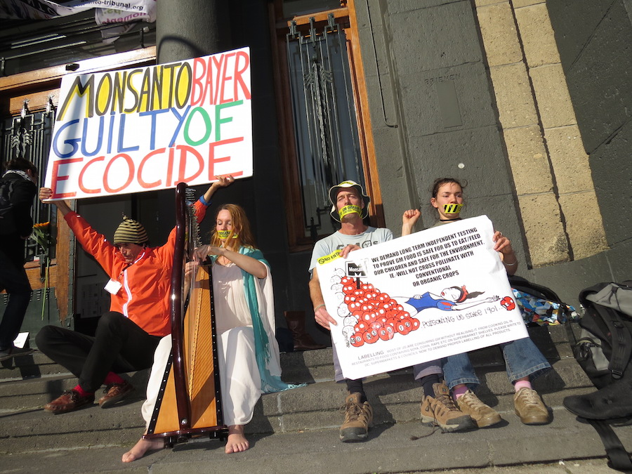 Activists protesting in front of the building where the Tribunal took place.