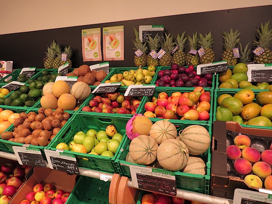 Organic fruits and vegetables offer in a German specialized organic shop.